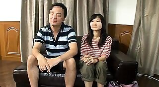 Caged Japanese nympho fingers her twat before erotic massage